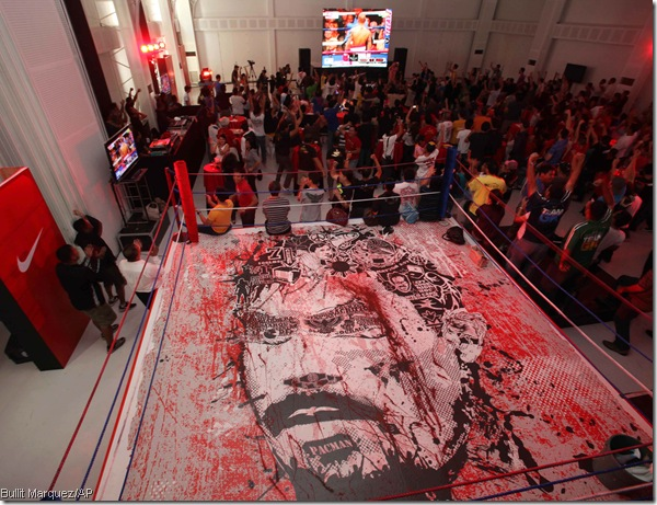 Thrilla in Manila: Filipino fans watch Pacquiao win in front of a giant mural of their hero