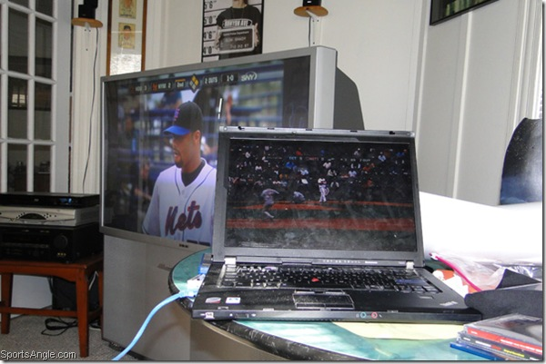 Johan on the TV, Strasburg on the computer, Eminem on the wall -- perfection